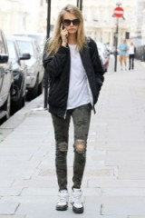 Cara street style…ripped camo print skinny jeans and black bomber jacket. Celebrity fashion | celebrities in denim | casual star style