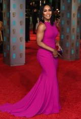 American actress Angela Bassett showed off her gorgeous curves in this hot pink Galia Lahov sleeveless gown, when she attended the 2016 BAFTA Awards. Star style | actresses on the red carpet | BAFTAs dresses | designer gowns | celebrity fashion