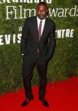 British actor Idris Elba, winner for Best Actor, at the 2016 Evening Standard British Film Awards, looked sharp on the red carpet dressed in a black suit, white shirt and burgundy tie. Celebrity fashion | actors in suits | star style | celebrities at events