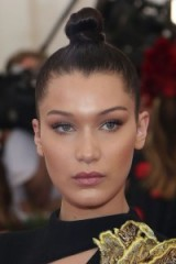 Bella Hadid's dark hair in a topknot – celebrity updos – hairstyles – make up & beauty