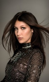 Bella Hadid with long dark sleek hair – celebrity hairstyles – beauty – make up