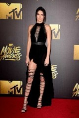 Model Kendall Jenner on the red carpet dressed in DSquared2 attending the MTV Movie Awards in California, April 2016. Models at events – long black dresses – glamorous looks