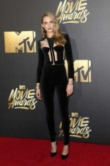 Cara Delevingne dressed in black velvet on the red carpet at the MTV Movie Awards in California, April 2016. Celebrity outfits – celebrities at events