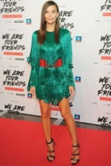 Actress Emily Ratajkowski wearing a sea-green fringed mini dress by Balmain