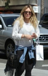Hilary Duff out shopping in Beverly Hills on 1 April 2016, carrying a Saint Laurent Anita fringed leather shoulder bag, similar styles available from matchesfashion.com & selfridges.com. Celebrity fashion | shoulder bags