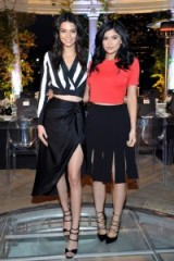 Kendall and Kylie Jenner wearing designs from their new fashion collection, attend the Neiman Marcus dinner celebrating the new Kendall + Kylie clothing line available from the department store, 31 March 2016. Celebrity fashion | outfits | skirts | tops