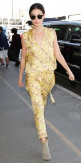Lily Aldridge travel style wearing a yellow silk printed top and matching cropped trousers, arriving at LAX airport, February 2016. Celebrity street style | chic outfits
