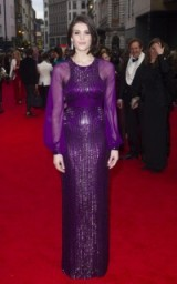 Actress Gemma Arterton wearing a shimmering purple Jenny Packham gown – red carpet arrivals 2016 Olivier Awards