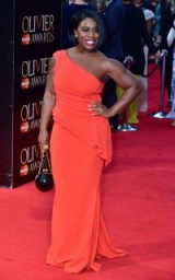 American actress Uzo Aduba wore a coral one shoulder gown and carried a black and gold spherical bag, when she attended the 2016 Olivier Awards in London