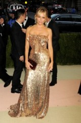 Sienna Miller wearing a jewel embellished rose gold gown by Gucci