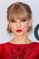Taylor Swift's chic updo with fringe. Taylor Swift hair | celebrity hairstyles | make up and beauty | celebrities with fringes | glamorous updos