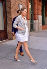 Blake Lively's pregnancy style gets better and better! she looked gorgeous out in New York wearing a silver and white dress, which featured a feathered skirt and embellished bodice, a slouchy grey sweat jacket and metallic silver Louboutin high heeled pumps…could she be the only one to pull this look off? – Blake Lively fashion – celebrity outfits
