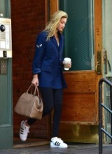 Gigi Hadid street style…blue blazer, leggings and white sneakers. Casual celebrity fashion – star outfits – models off duty