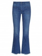 STELLA MCCARTNEY Star-distressed cropped kick-flare jeans ~ designer clothing ~ casual fashion ~ flares ~ blue denim ~ stars ~ crop style hem ~ flared
