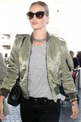 Model Rosie Huntington-Whiteley green silk bomber jacket and chic accessories. Casual celebrity jackets | star style outfits | models off duty