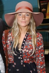 Sienna Miller boho style with mixed floral prints and floppy wide brim hat