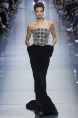 A model walks the runway for Armani Privé Haute Couture Fall/Winter 2016 at Paris fashion week, July 2016 – models on the catwalk – chic elegant designer clothing – red carpet gowns – long event dresses – black velvet – embroidered bodice – elegance