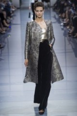 A model walks the runway for Armani Privé Haute Couture Fall/Winter 2016 at Paris fashion week, July 2016 – chic elegant designer clothing – statement coats – velvet trousers – luxe outfits