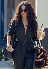 Vanessa Hudgens long dark curly hair. Celebrity hairstyles | street style | star style jumpsuits | accessories | sunglasses