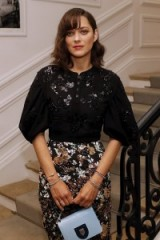 Actress Marion Cotillard looking stylish at the Christian Dior 2016-2017 fall/winter Haute Couture fashion show in Paris, 4 July 2016. Celebrity fashion | chic outfits | front row celebrities | French style