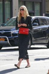 Elsa Hosk street style chic…long sleeved black dress, red Chanel flap bag and two tone flats. Celebrity fashion | models off duty | Chanel beige and black flat shoes | iconic handbags | outfits