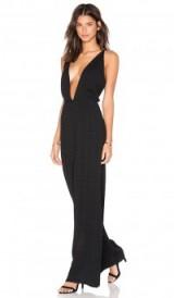 KENDALL + KYLIE DEEP V JUMPSUIT black. Plunge front jumpsuits   evening fashion   plunging neckline   going out