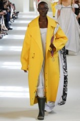 Maison Margiela Haute Couture Fall/Winter 2016 at Paris fashion week, July 2016 – designer outerwear – runway models – long yellow coats – unconventional outfits