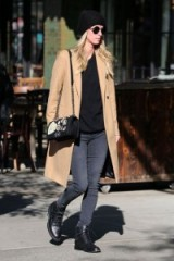 Nicky Hilton casual street style dressed in black skinny jeans outfit & camel coat