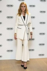 Olivia Palermo wearing an ivory belted blazer and cropped trousers from ZARA, attends the RIMOWA store opening in London, 29 June 2016. Celebrity fashion | star style outfits