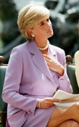 Princess Diana looking glamorous in a lilac suit and pearl jewellery