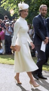 Pippa Middleton chic in a cream Emilia Wickstead dress, ivory Jane Taylor hat, nude high heeled courts and a pink box clutch, attending Princess Charlotte's christening at St Mary Magdalene Church, Sandringham, July 2015. Celebrity outfits | designer dresses | elegant looks