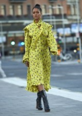 Rihanna out in stockholm rocking a yellow flower print vetements dress & leather boots