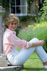 Princess Diana in the garden at Highgrove dressed in white dungarees and pink shirt
