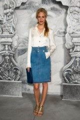 Poppy Delevigne ivory satin blouse, straight blue denim skirt, with button detail and embroidered edging and a pair of gold shimmering sandals. Celebrity outfits   casual luxe fashion   style icons   celebrities wearing skirts