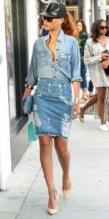 Rihanna wearing double denim with Chanel jewellery. Celebrity street style   distressed blue skirts   casual star outfits