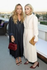 Mary-Kate and Ashley Olsen attend the launch of the opening of their first Elizabeth and James store in Los Angeles, July 2016. Olsen twins style | celebrity fashion | chic outfits | coats and accessories