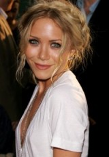 Ashley Olsen with her hair in a braided updo. Boho hairstyles   Olsen twins make up and beauty   celebrity style braids   messy updos