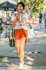 Vanessa Hudgens in an Adidas tee and shorts. Celebrity street outfits | casual star style | sporty fashion