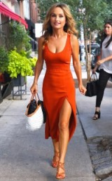 Italian born chef Giada De Laurentiis summer street style out in New York City…burnt orange sleeveless midi dress, with a low scooped neckline and high front slit, and a pair of strappy tan heels. Celebrity dresses | star style outfits