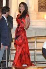 Amal Clooney evening glamour in a red and black print gown