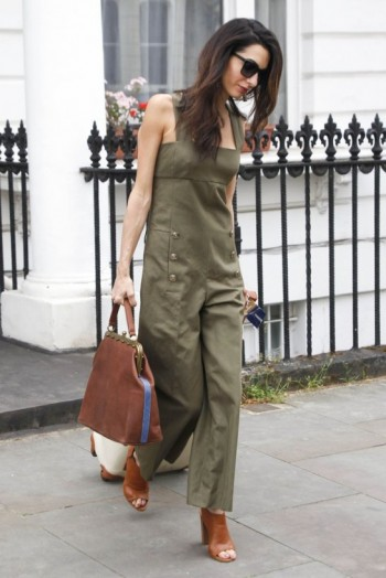 Casual chic in a khaki jumpsuit, tan leather peep toe mules and brown holdall ~ celebrity travel style ~ Amal Clooney's travelling wardrobe
