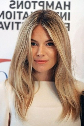 Sienna Miller with long blonde hair - flipped