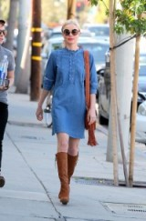 Kate Bosworth street style wearing a blue denim shift dress with scalloped piping, light brown suede knee high boots and a tan fringed shoulder bag. Casual celebrity outfits | star style dresses | fashion