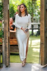 Kim Kardashian looked chic out for lunch with her family in August 2016 wearing an ivory long sleeved bodysuit, satin side slit maxi skirt and gold strappy high heeled sandals. Celebrity outfits | star style fashion | silky skirts | Kardashian's wardrobe