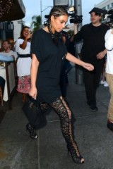 Kim…braids, long black tee, and lace up thigh high boots. Kardashian outfits | Kardashian's style | celebrity fashion