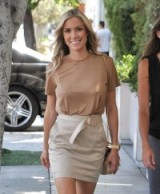 Reality star Kristin Cavallari out in West Hollywood wearing a beige d-ring belted mini skirt with side pockets and a contrasting camel colour tee ~ celebrities wearing skirts ~ neutral street style outfits ~ neutrals ~ celebrity fashion