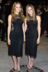 Mary-Kate and Ashley Olsen in 2002 attend the Vanity Fair Oscar Party, both dressed in black lace dresses. Olsen twins style | celebrity fashion | star style | LBD