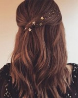 Ashley Tisdale half up half down hair with star embellishments. Celebrity hairstyles | long dark hair | gold stars