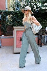 Paris Hilton in Saint-Tropez ~ 70s style summer outfits ~ casual chic ~ celebrity street style outfits ~ wide leg jumpsuits ~ floppy hats
