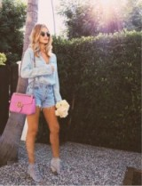 GUCCI GG Marmont matelassé shoulder in pink leather – as worn by Rosie Huntington-Whiteley with a faded blue demin shirt and frayed shorts on Instagram, August 2016. Celebrity hand bags | luxe designer accessories | star style quilted handbags | flap bag with gold chain strap